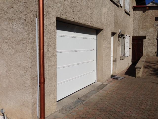 Remplacement d 39 une porte de garage allo porte de garage for Reglage porte de garage basculante