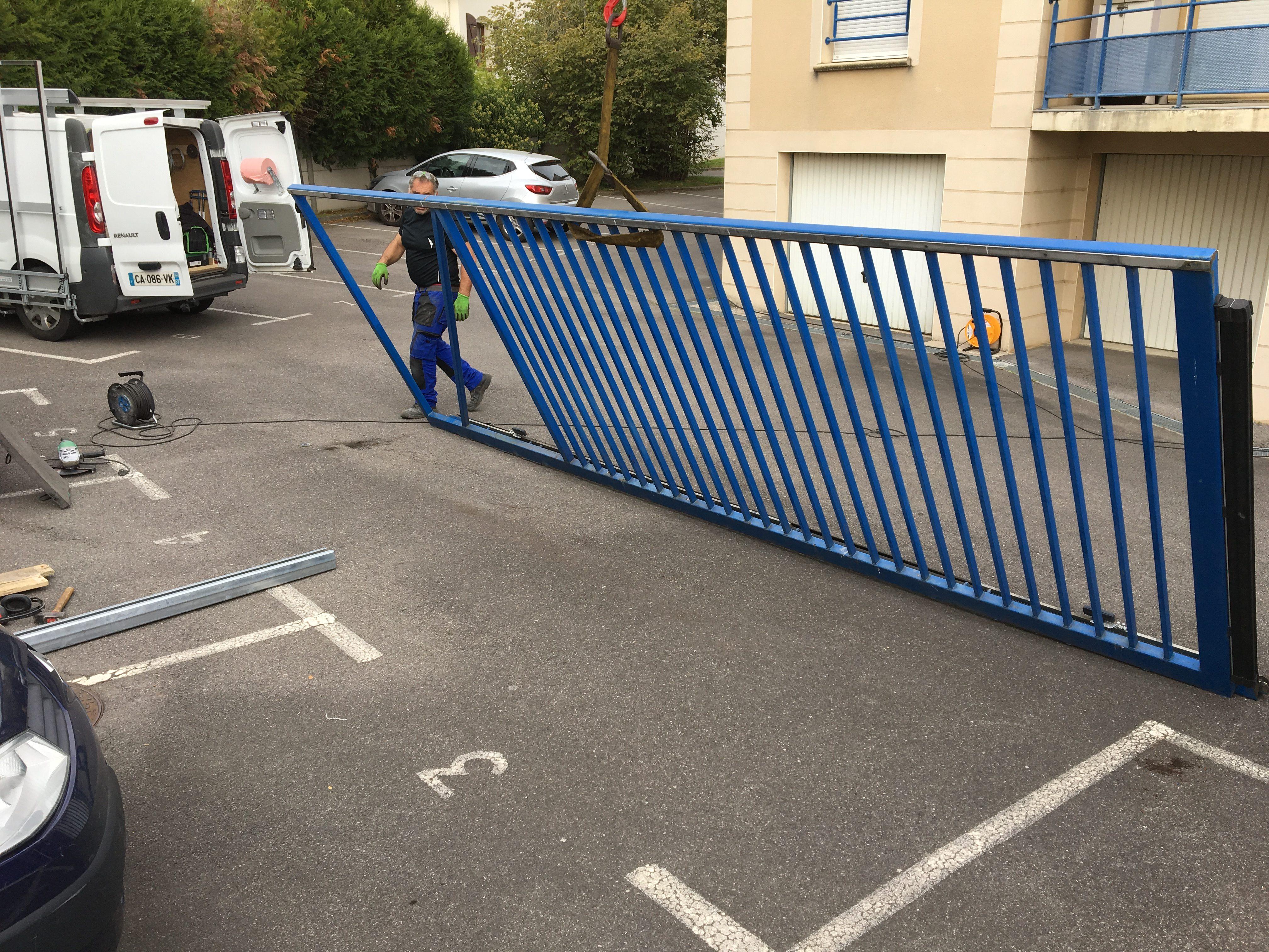 R paration portail coulissant copropri t allo porte de for Reparation porte garage